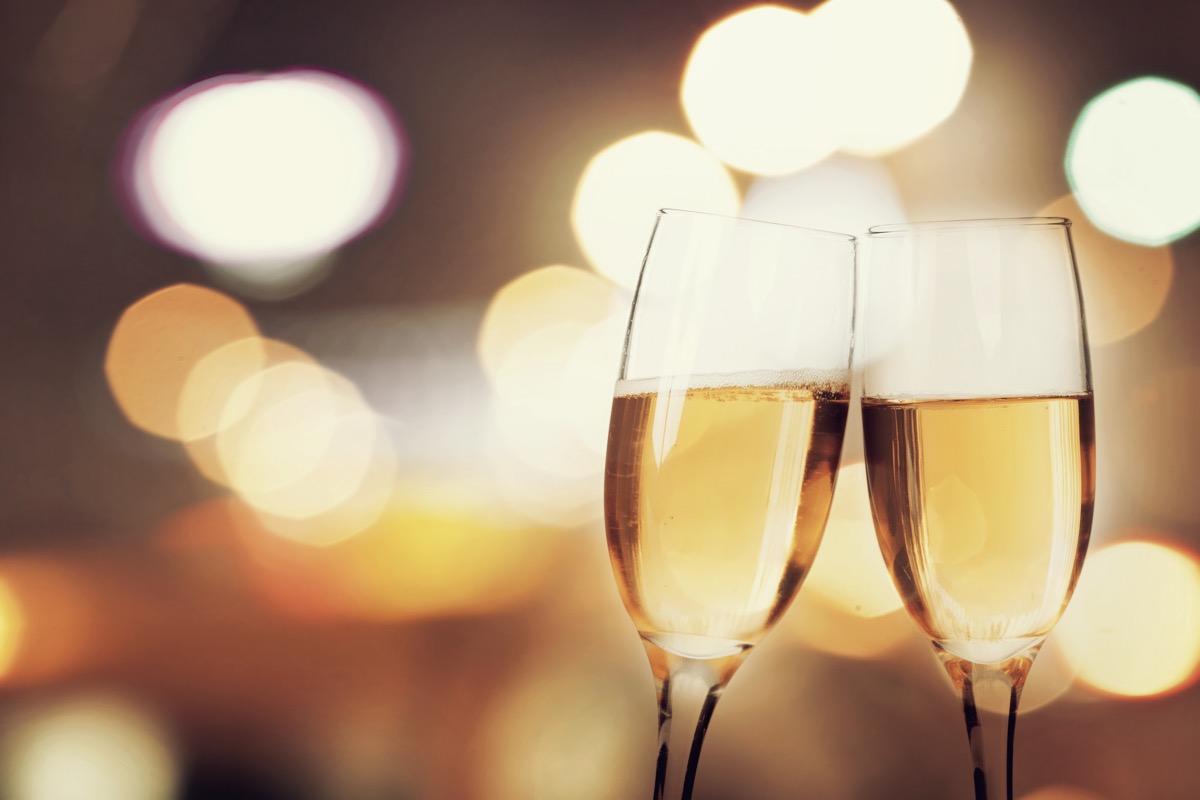 Champagne glasses against sparkling background