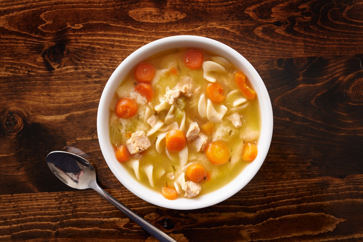 chicken noodle soup on wooden table