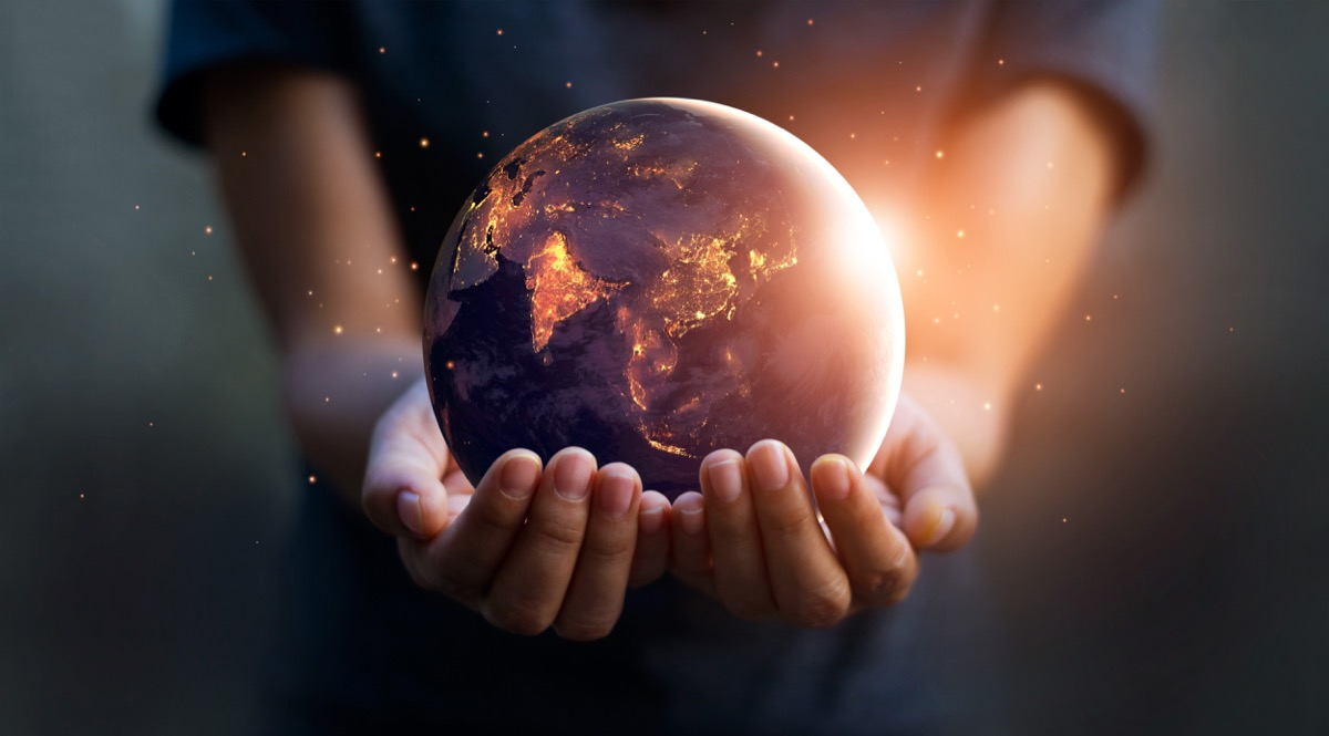 child holding the world in his hands