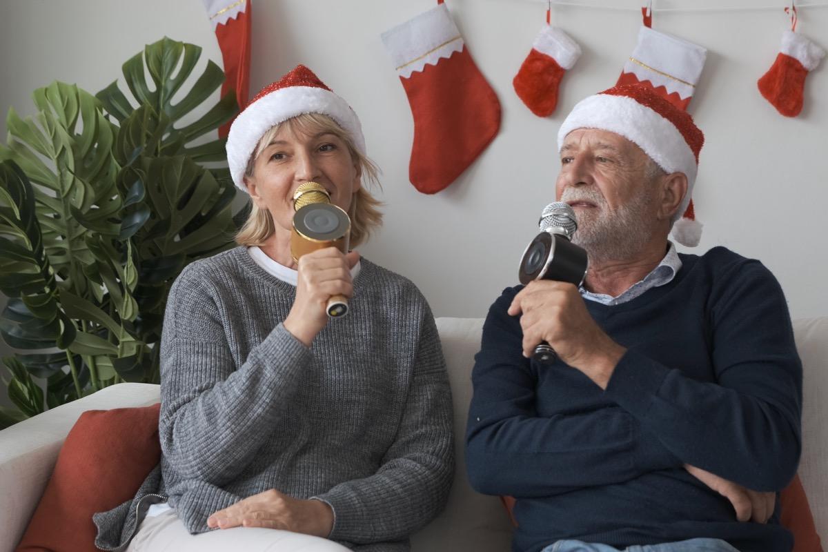 two older people singing christmas karaoke