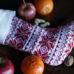 christmas stocking with nuts apples and oranges