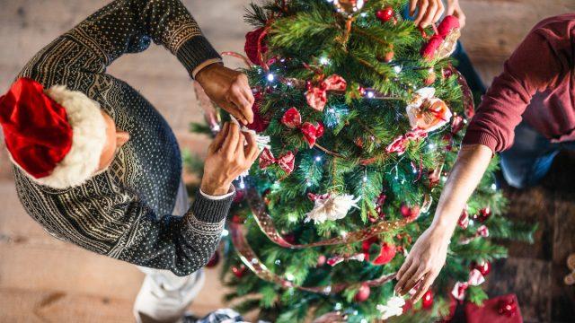 overhead shot of grandparent decorating christmas tree