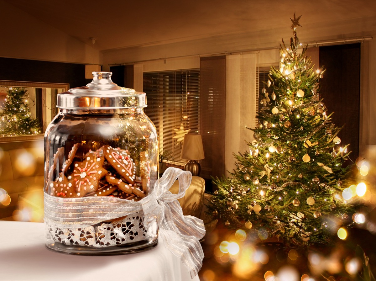 christmas tree in festive room with cookies in the foreground