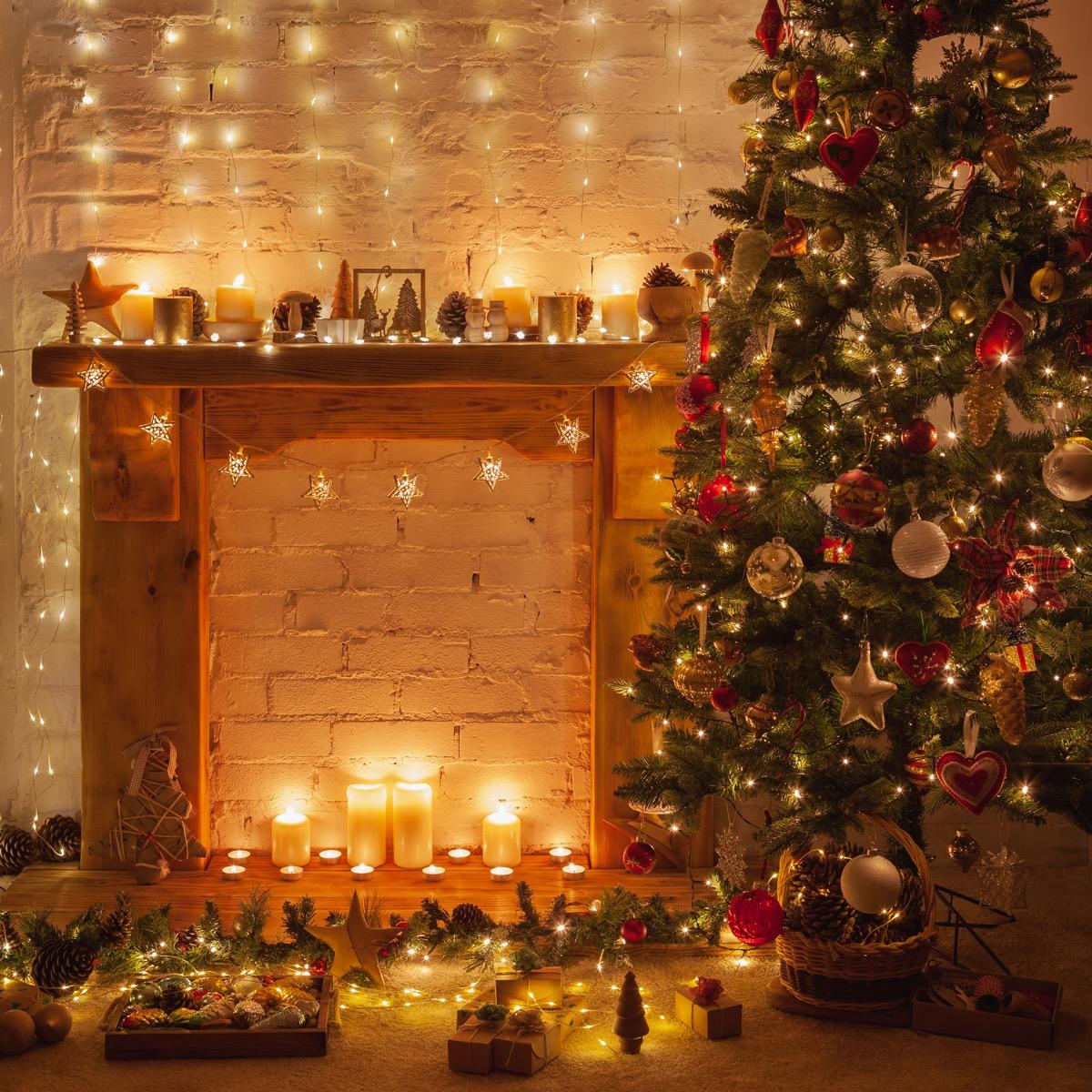 christmas tree near a fireplace