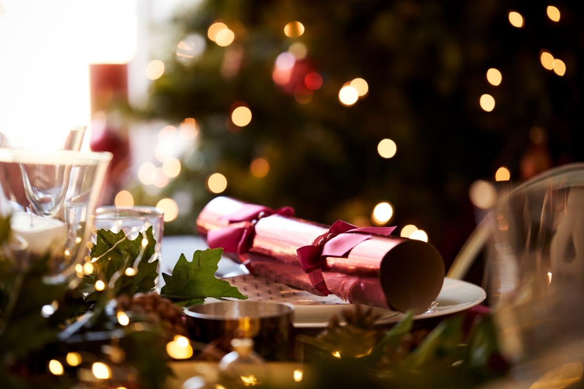 Christmas cracker on plate at Christmas dinner