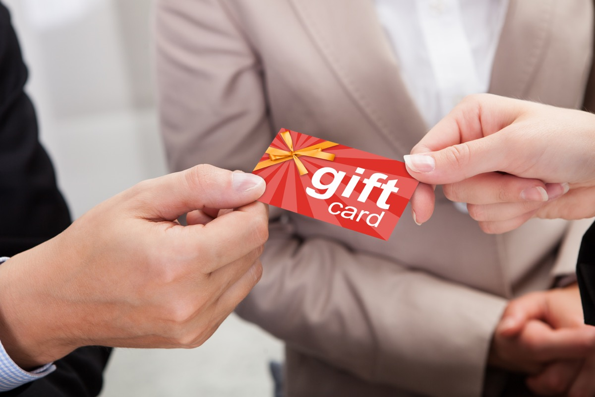 close up of people holding a gift card
