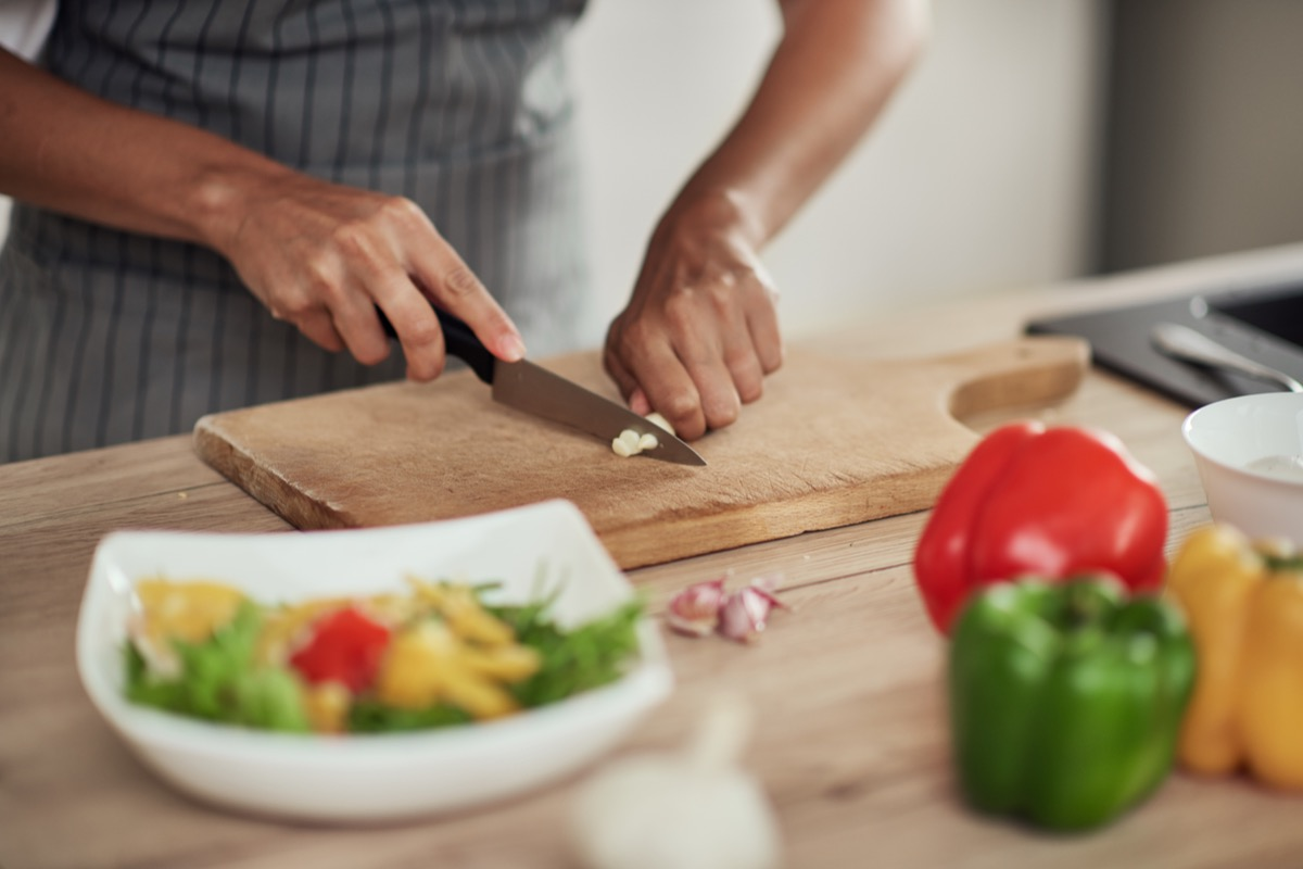 close-up of woman chopping vegetables