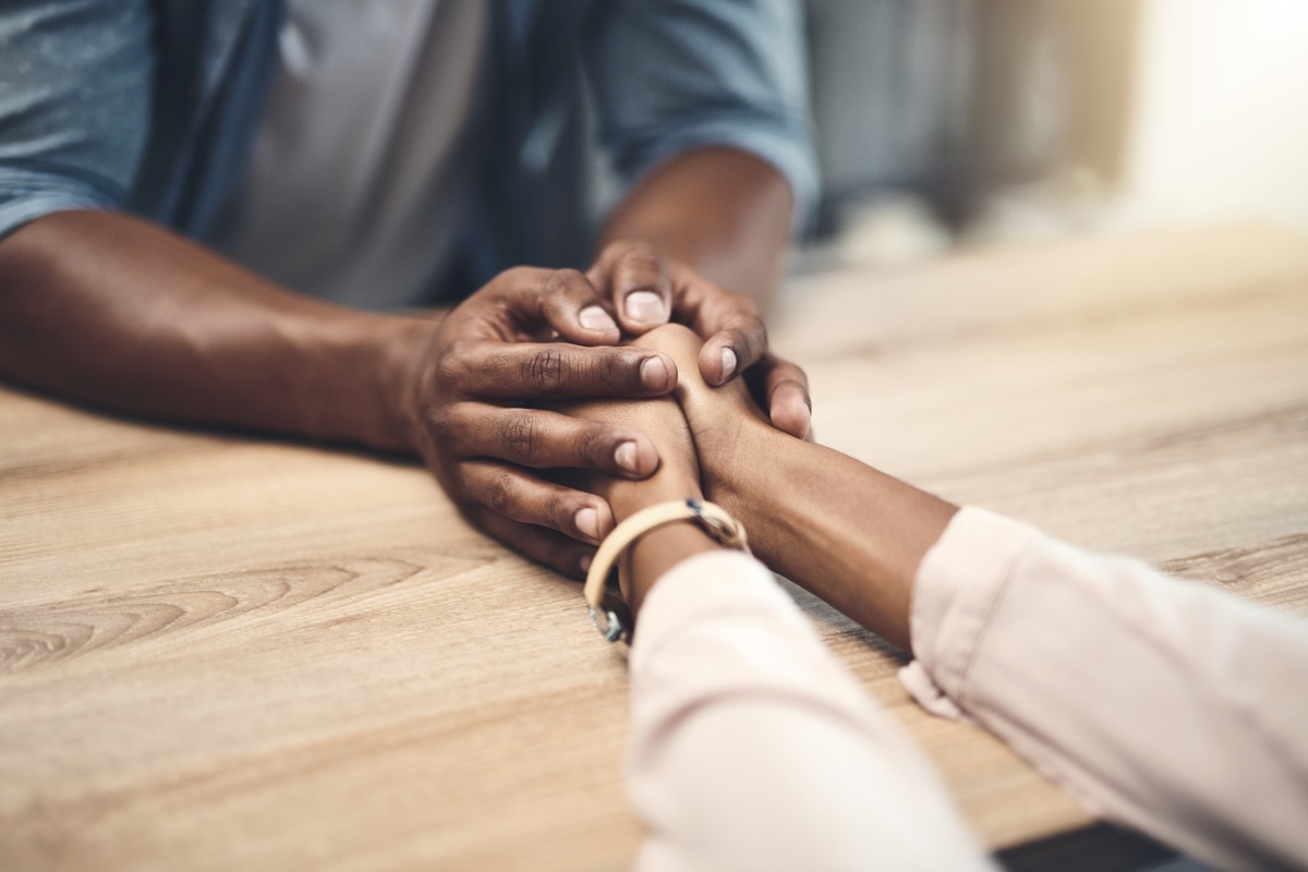 couple holding hands in gratitude to say thank you