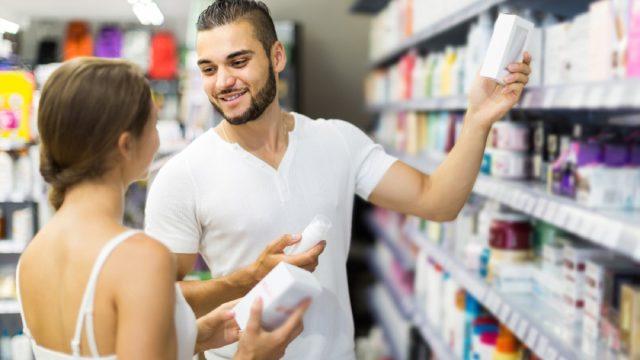 white couple shopping at drugstore