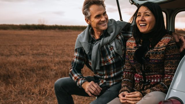 man surprising his wife with a outdoor sunrise trip