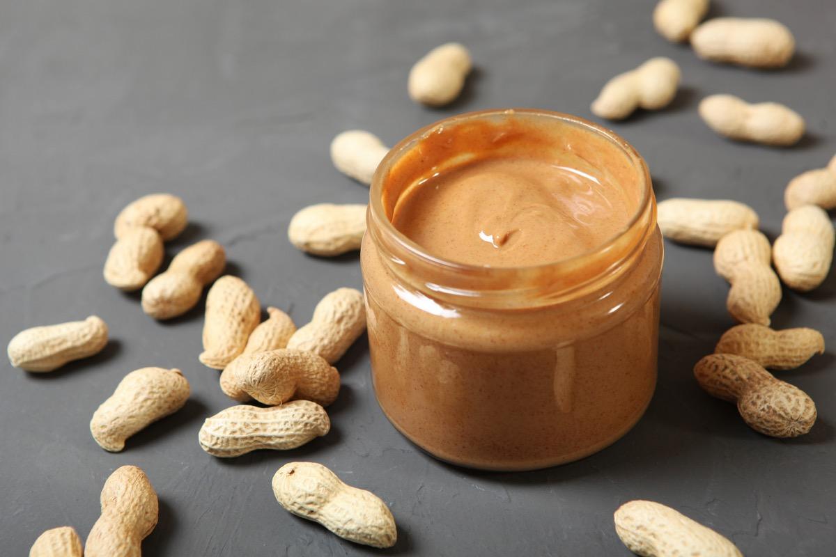 creamy peanut butter on table
