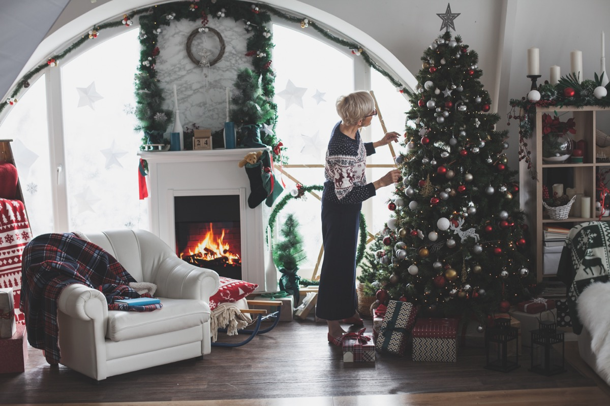 woman decorating her home for christmas
