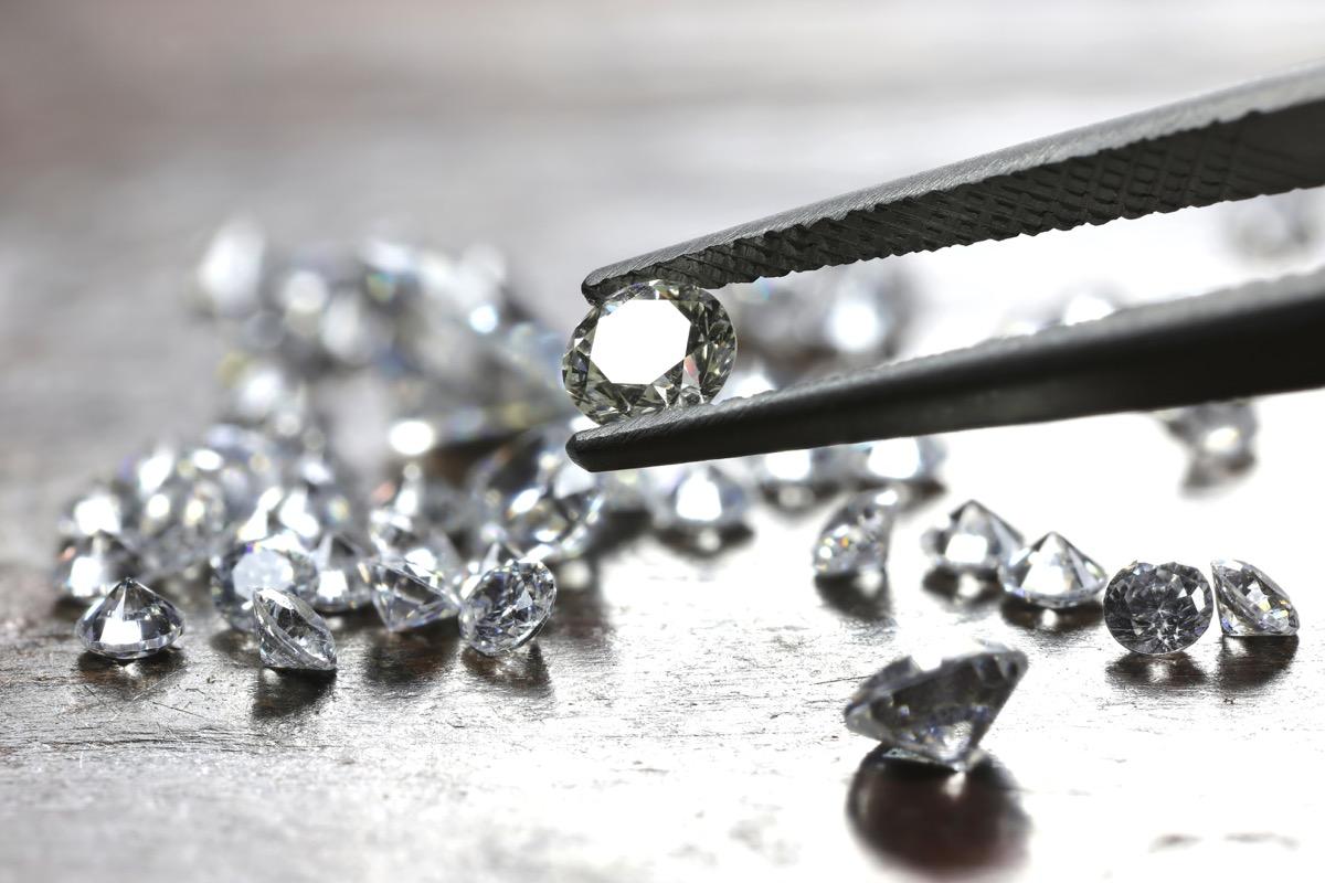 diamond held by tweezers