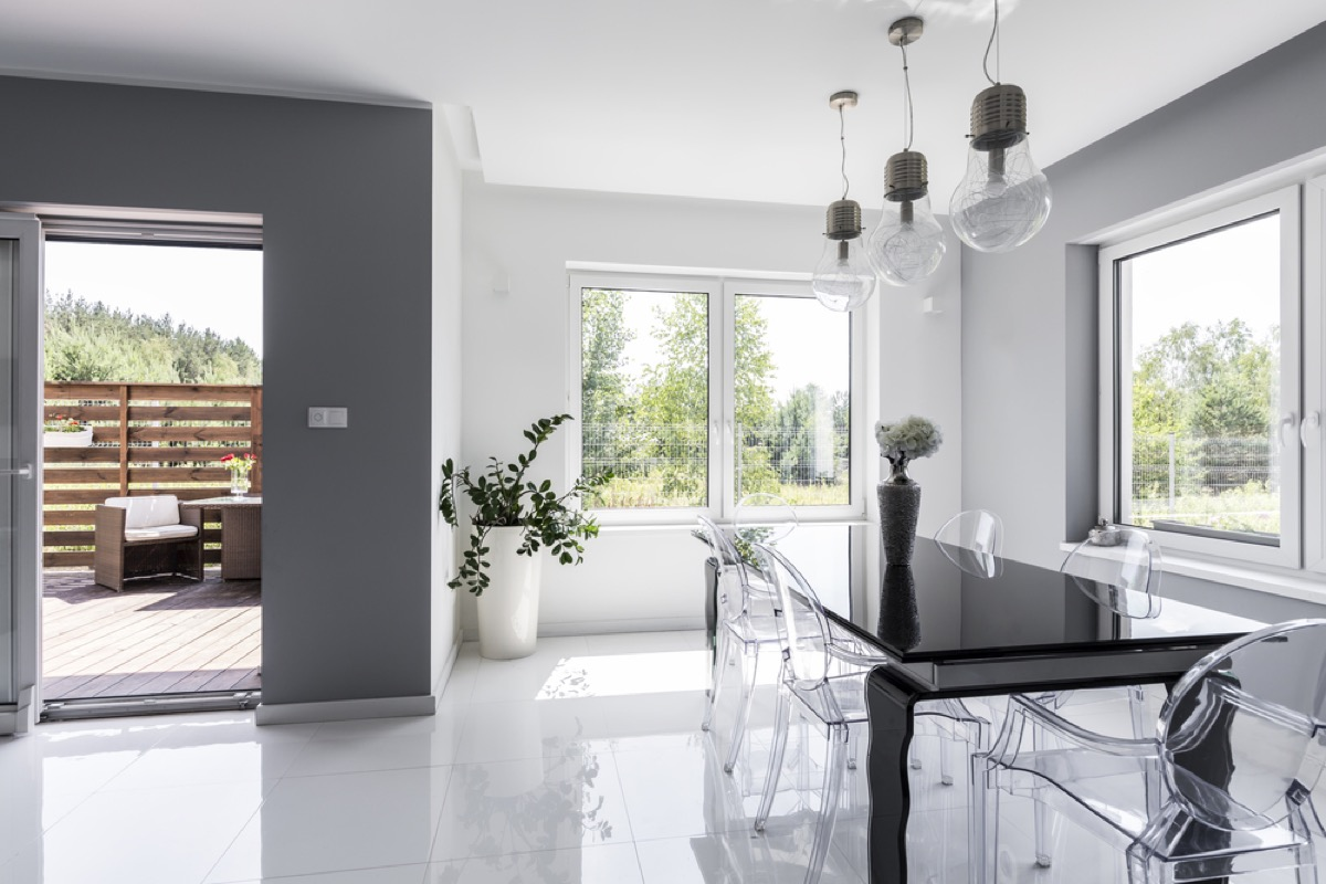 gray dining room with clear chairs