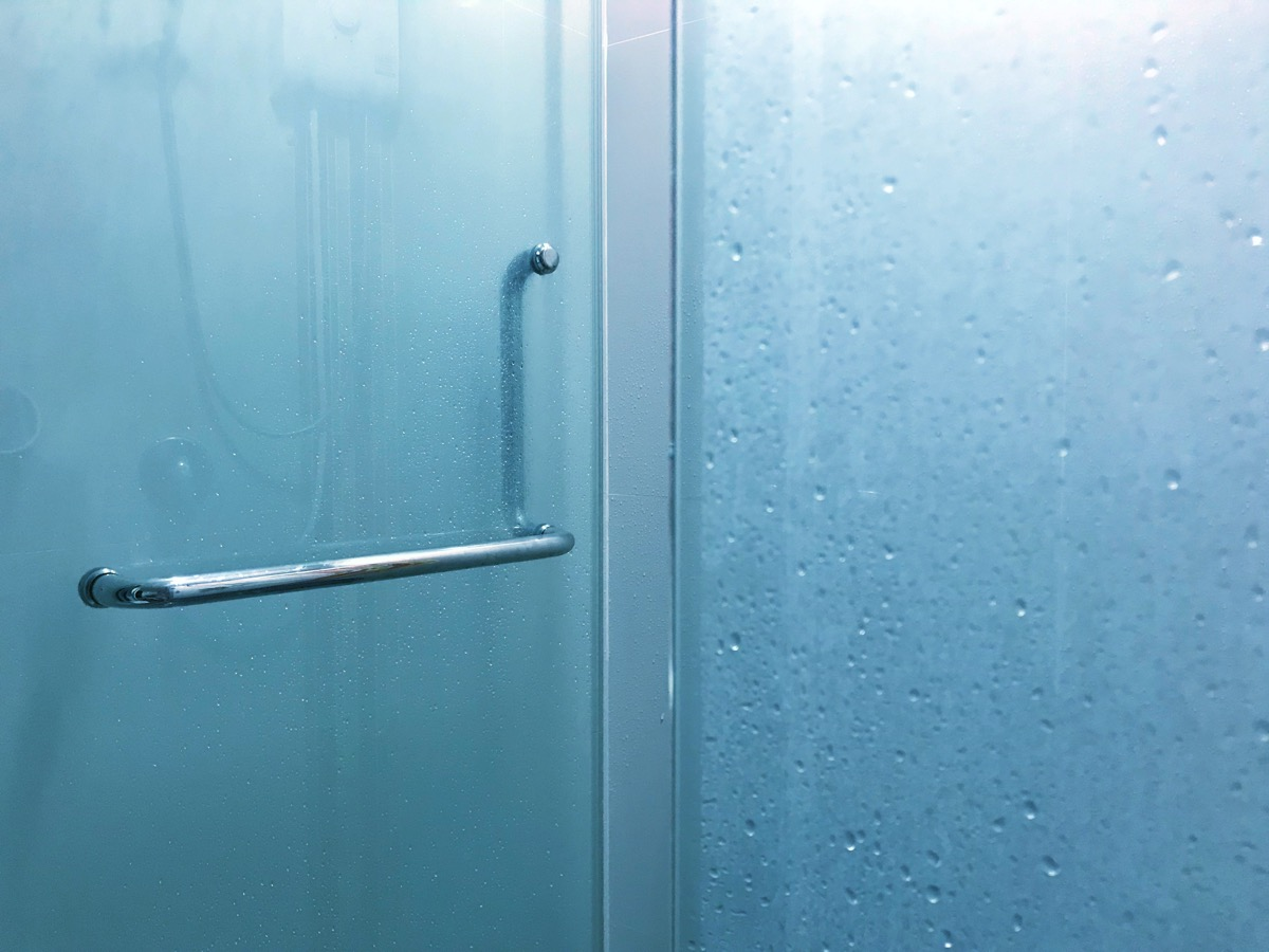 dirty fogged up glass shower door