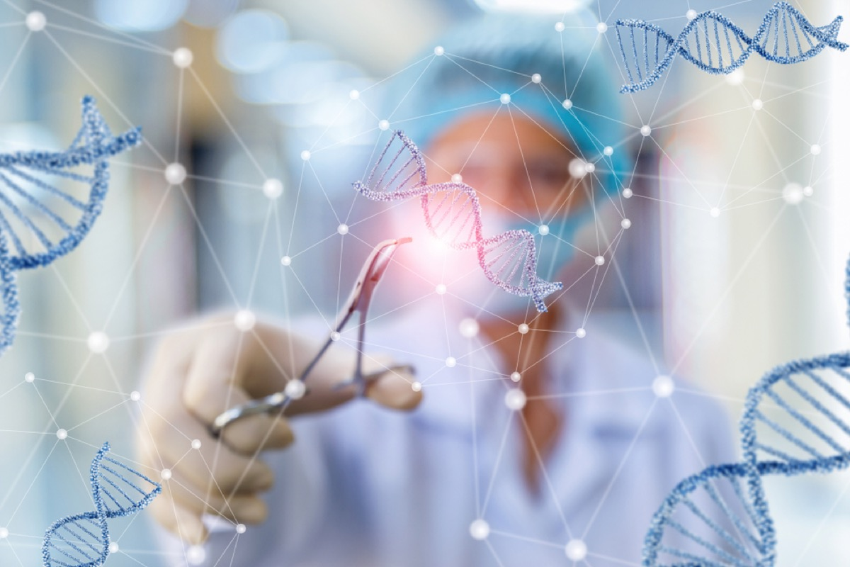 doctor cutting DNA helix