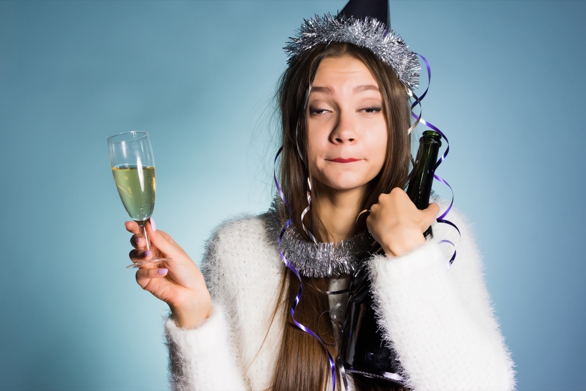 drunk woman holding champagne glass