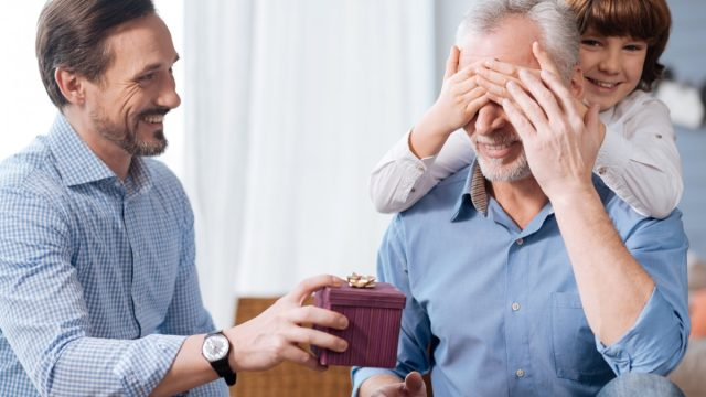 elderly man being surprised with gift