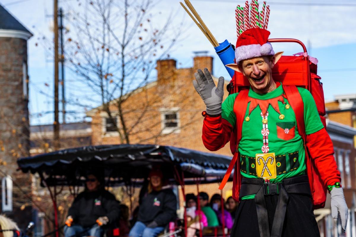 elf waving in christmas parade