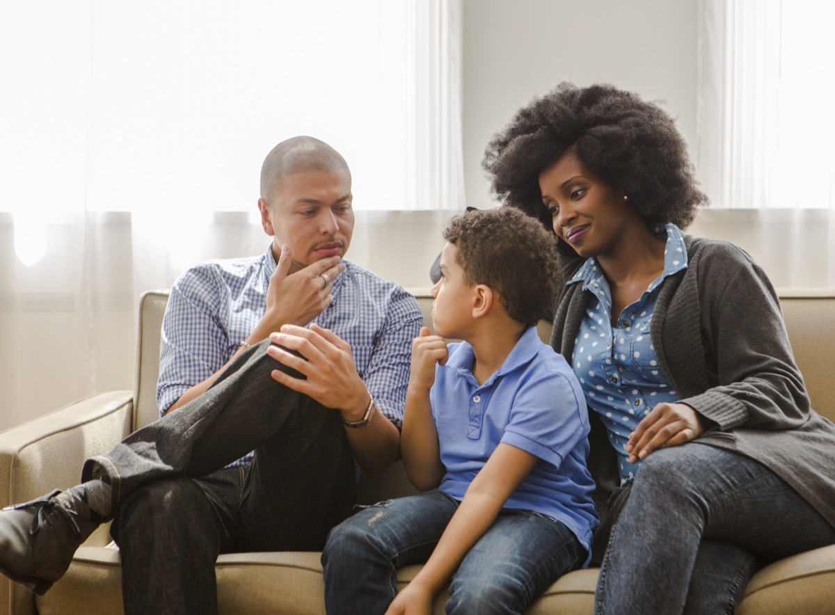 """A couple having a """"the talk"""" with their young son."""