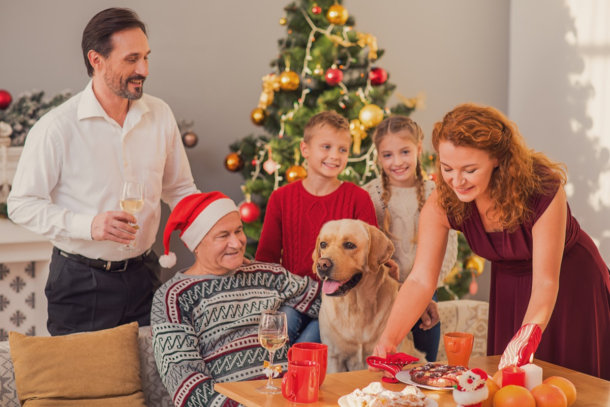 family with dog celebrating new years