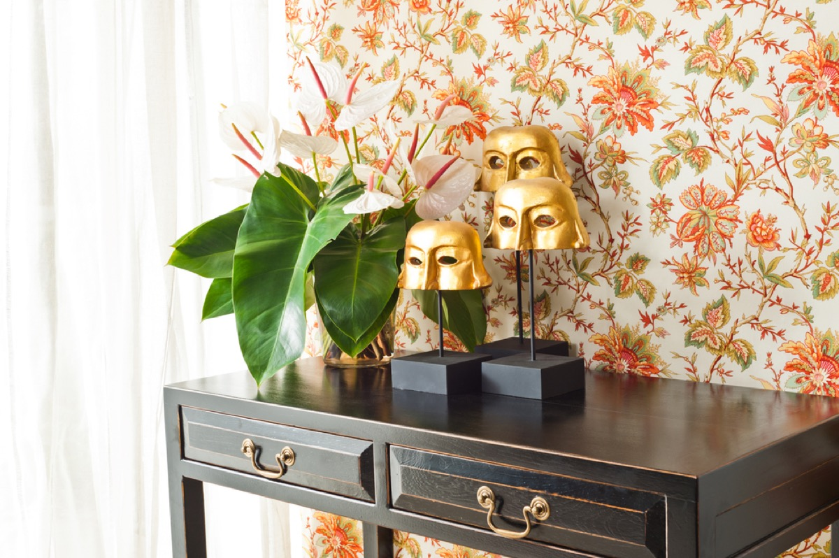 entryway wall with orange floral wallpaper
