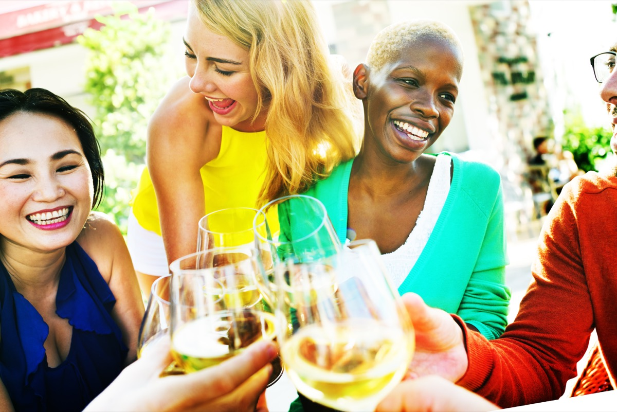 Older female friends hanging out and having some wine