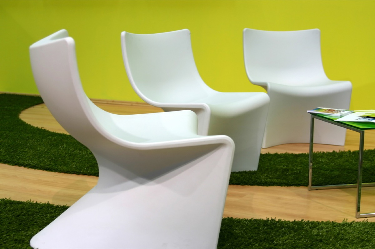 set of three futuristic whote chairs in yellow living room