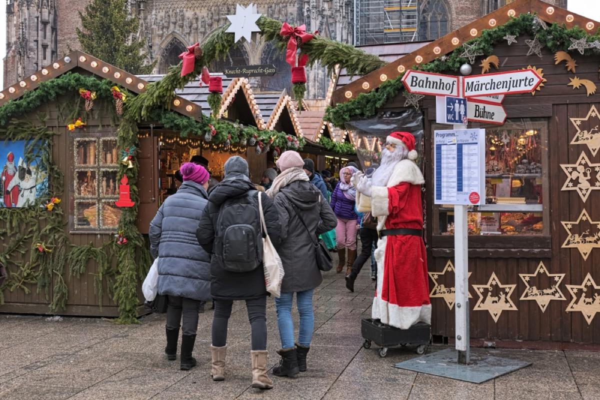 entrance to german christmas market features santa statue