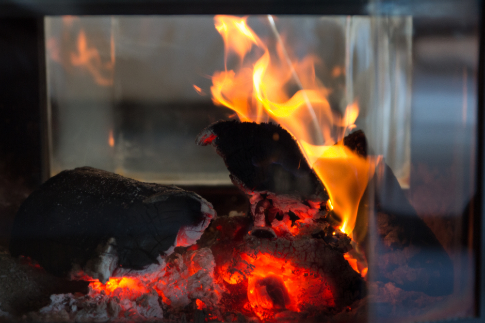 fire behind glass cover