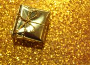 gold christmas gift on gold background