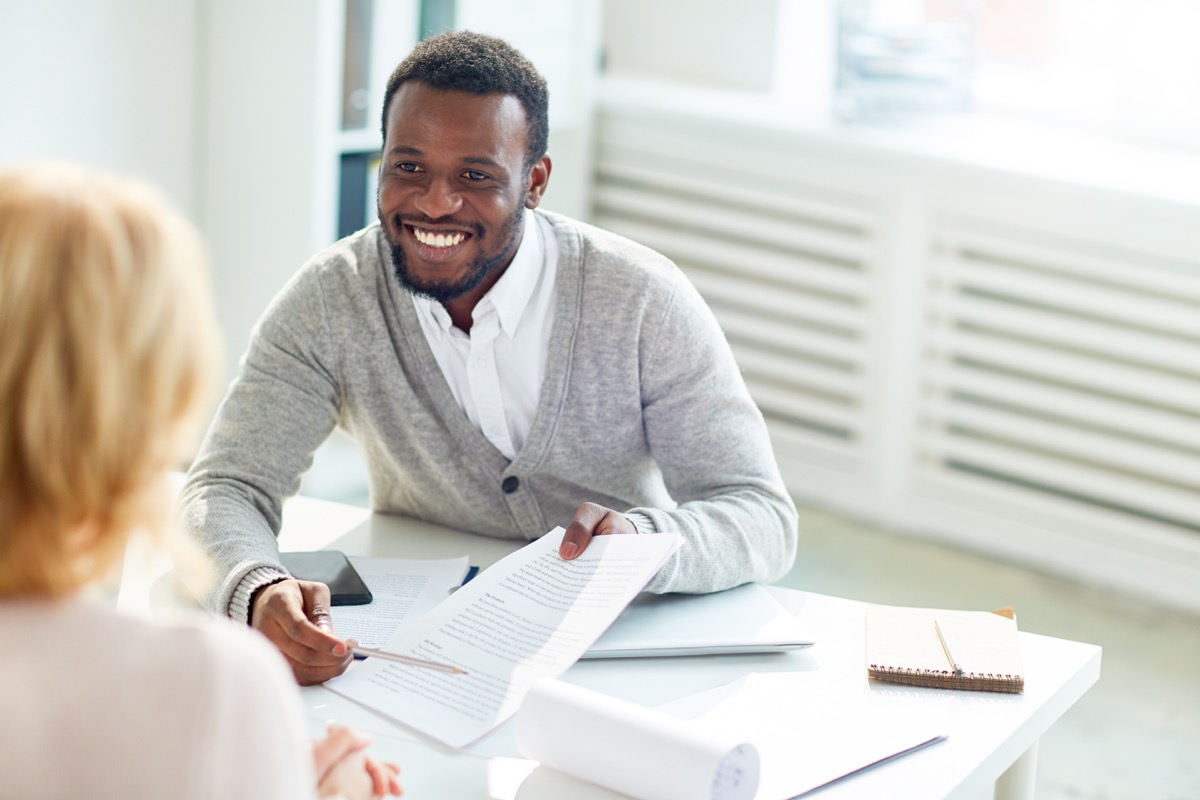 happy businessman pointing at contract