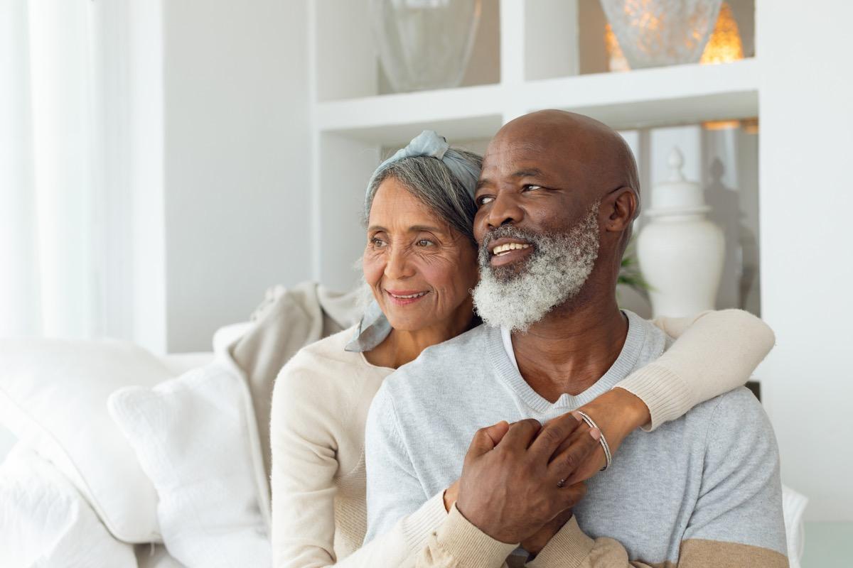 happy senior couple on couch