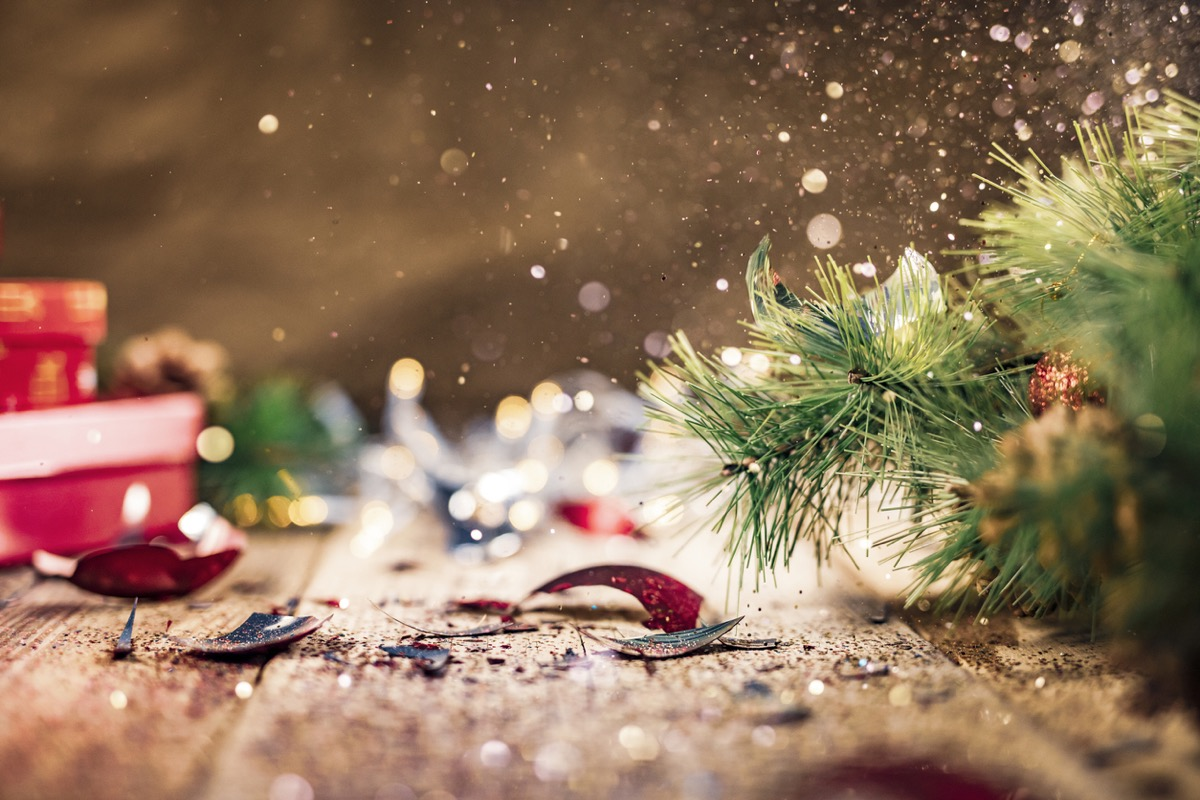 broken ornaments under a christmas tree