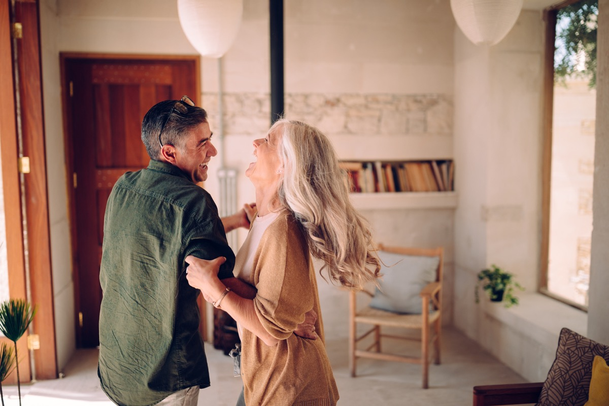 older white couple dancing at home