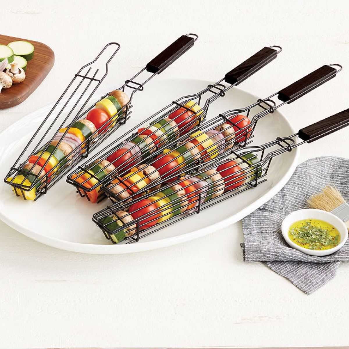 kabob griling baskets with vegetables in them