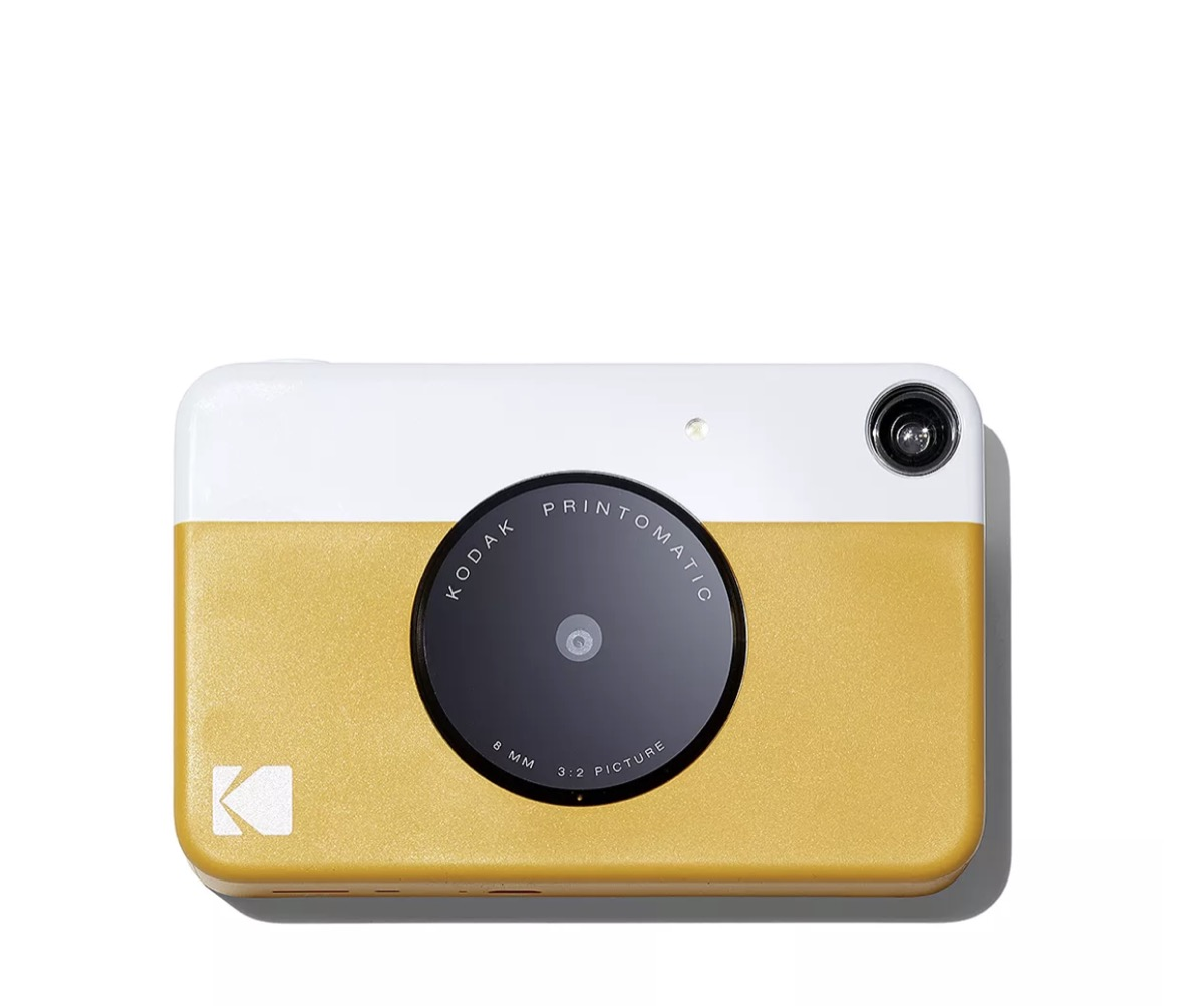 kodak printomatic instant print camera in yellow and white