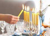 Lighting a menorah for Hanukkah