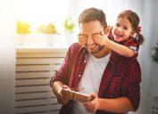 little girl surprising dad