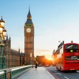 double decker bus across from big ben in london