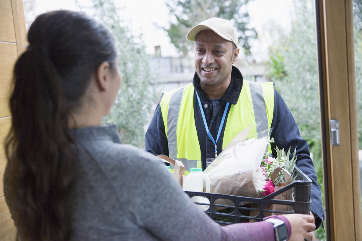 food man delivering groceries to woman