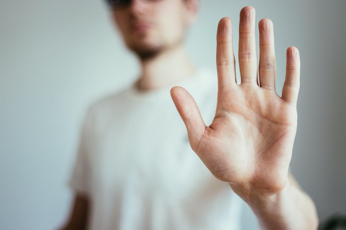 man showing stop gesture