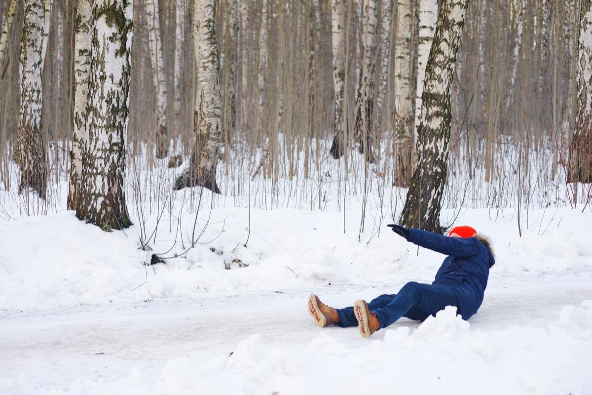 man slipping on snow