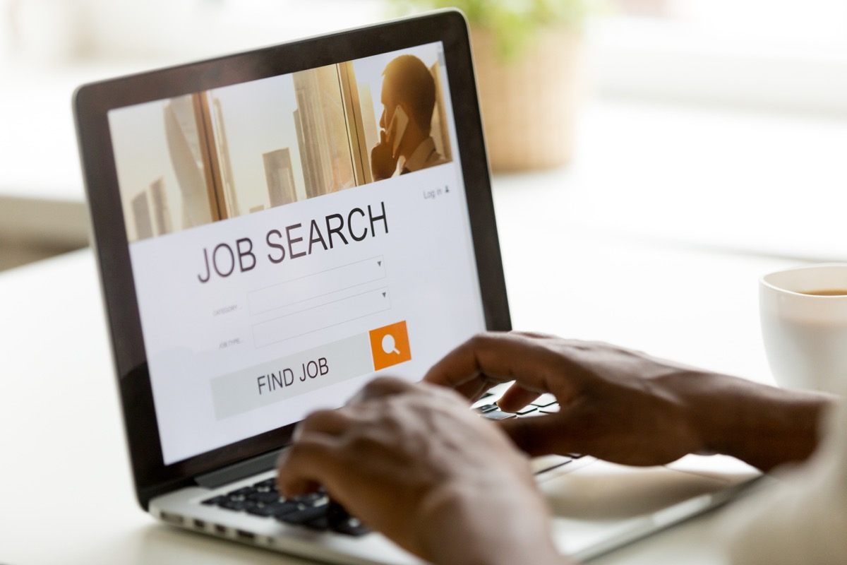 man using laptop to search for jobs