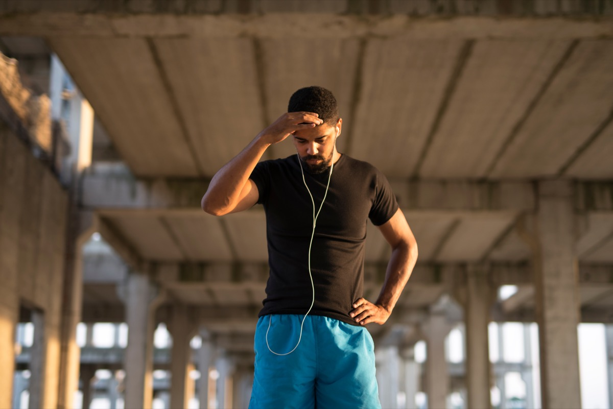 Black man feels dizzy while he is going for a run
