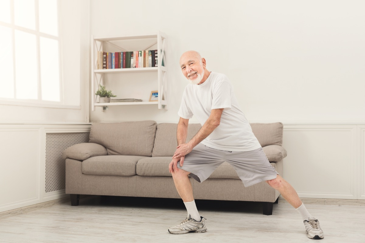 Senior man working out at home