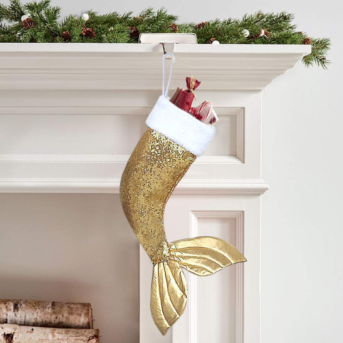 gold stocking with mermaid tail hung on mantle