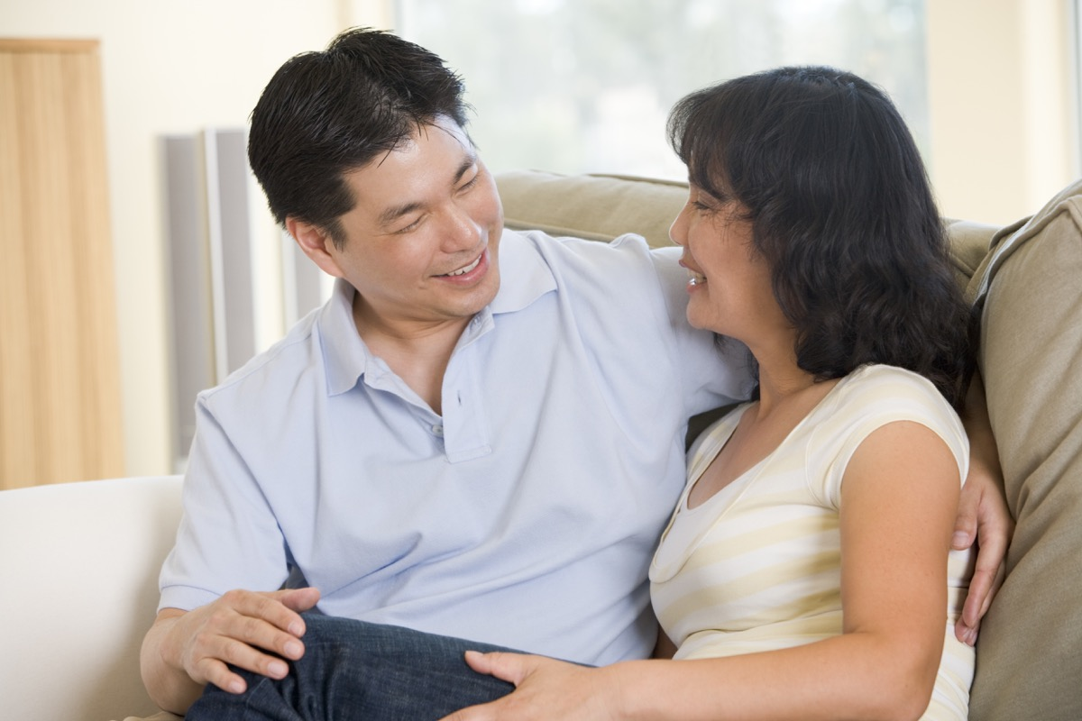 middle aged asian couple talking