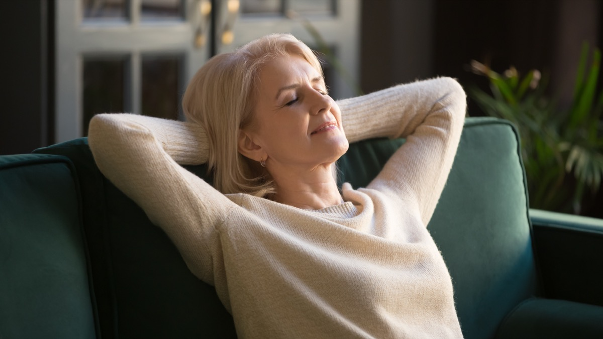 middle aged woman relaxing on couch