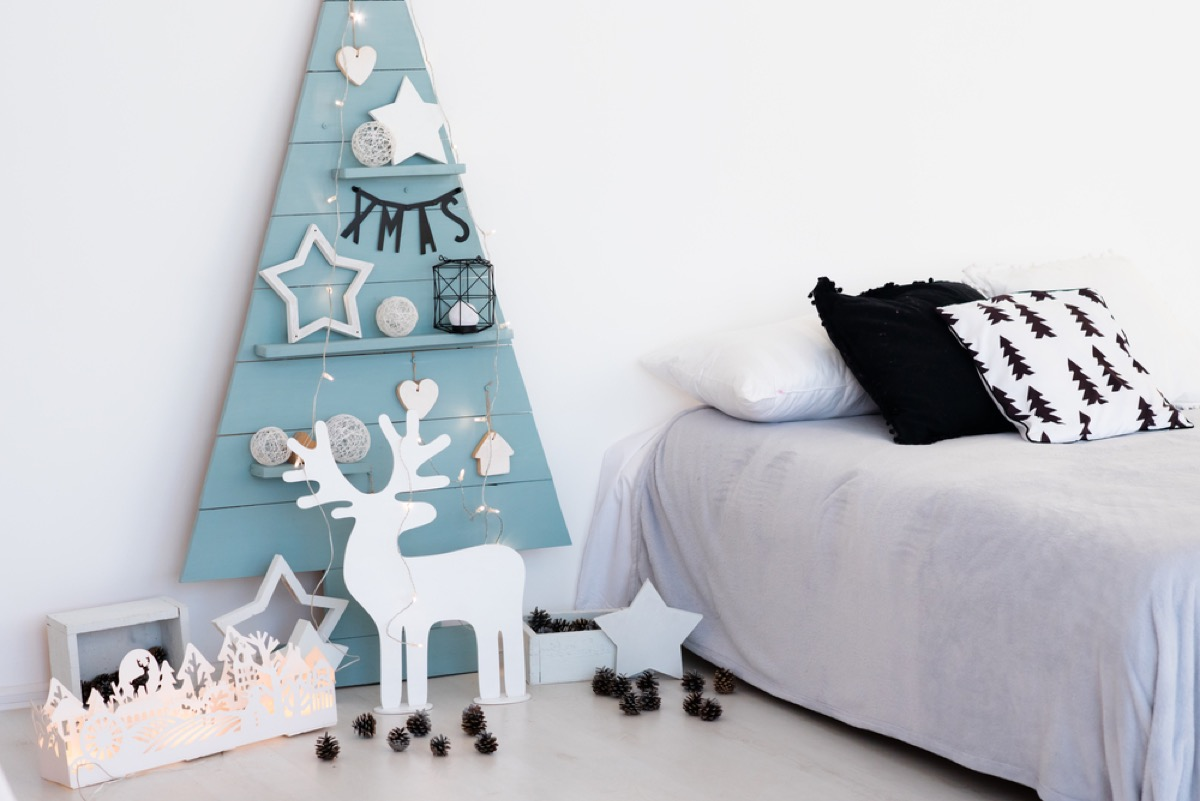 child's bedroom with blue wooden christmas tree